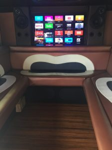 TV and custom seats in armored truck limo